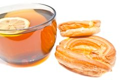 Two donuts and cup of tea Stock Photo