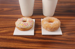 Two donuts on an office desk Stock Photography