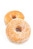 Two donuts powdered with sugar Royalty Free Stock Image