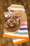 Two donuts on table Stock Photography