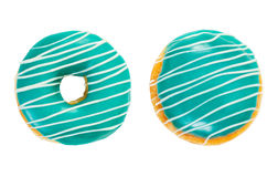 Two donuts turquoise color with white stripes. Isolated on white background. Top view stock photo