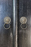 Two Door Knobs of  Rings Made of Black Iron Royalty Free Stock Photos