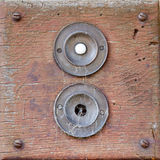 Two doorbells, one broken and covered in cobwebs Royalty Free Stock Photo