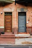 Two Doors. Near symmetry between two front doors, side by side. Philadelphia, PA Stock Image