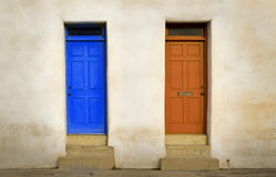 Two doors. Two door ways with bold colors on stone wall background Stock Photo & Two Doors Two Ways Stock Photos - Royalty Free Pictures