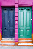 Two doors and four colors royalty free stock photos