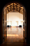 Two doors leading into a large hall. Arch with two doors leading into a large light hall Royalty Free Stock Photo