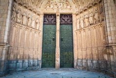 Two doors to cathedral of Toledo in Spain, Europe. Entrance to beautiful cathedral in Spain. Famous old church in Toledo. Two green doors and walls with Royalty Free Stock Image