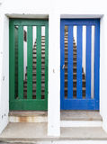 Two doors to different houses royalty free stock photos