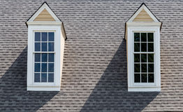 Two Dormers on Asphalt Roof Royalty Free Stock Photography
