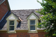 Two Dormers on Brick Homes with Wood Shingles Stock Images