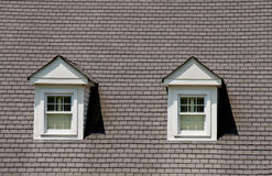 Two Dormers on Grey Shingle Roof Stock Photography