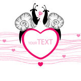 Two dotted black snails with pink heart Stock Photo
