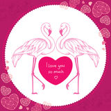 Two dotted pink flamingo with red heart in the round frame.  Royalty Free Stock Photo