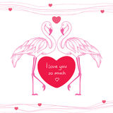 Two dotted pink flamingos couple in love with red heart Royalty Free Stock Photos