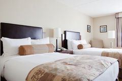 Two Double Beds in a Bedroom Royalty Free Stock Photos