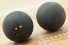 Two double yellow dot squash balls Royalty Free Stock Photography