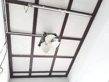 Two doves, nesting on a white ceiling fan royalty free stock photography