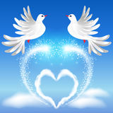 Two doves in the sky and heart. Flying two white doves in the sky and heart with sparkling salute Stock Image
