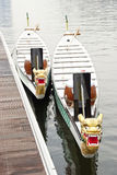 Two dragon boats tied up at jetty Stock Photography