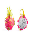 Two dragon fruits, whole and a half Royalty Free Stock Photo