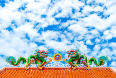 Two dragon on red roof with cloudy blue sky, Chinese temple in T Stock Images