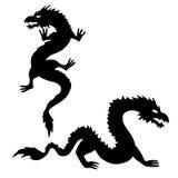 Two Dragon Silhouettes Set 2 Stock Photo