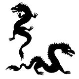 Two dragon silhouettes set 2 Stock Photo