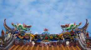Two dragon statue on temple roof Stock Photos