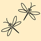 Two dragonflies silhouette on the creamy background Stock Images