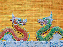Two dragons. On wood background Royalty Free Stock Images