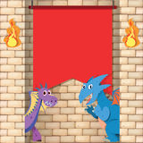 Two dragons behind the brick wall Stock Photo