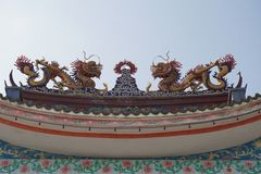 Two dragons. Of Chinese fables on rooftop of the door gate Royalty Free Stock Photo