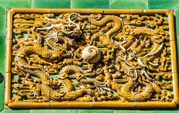 Two dragons are curvetting with a pearl. Photoed in Confucian Temple, Beijing Royalty Free Stock Photography