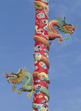 Two dragons. On pillar on blue sky Stock Photo
