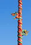 Two Dragons on Red Pillar isolated on Blue Sky Background. Twin Dragons on Red Pillar isolated on Blue Sky Background Stock Photo