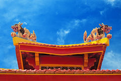 Two dragons on the roof of a Buddhist temple. Two colorful dragon on the roof of a Buddhist temple against the blue sky Stock Photography