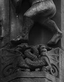 Two dragons. Shot in black and white. Placed on the facade of this historic building, sculpture representing two dragons on a fight. Set in Gothic, Barcelona royalty free stock photos