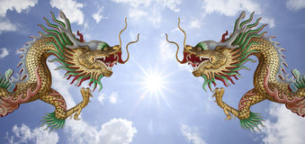 Two dragons and the sun. With blue sky Royalty Free Stock Image