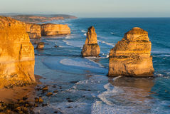 Two of the dramatic Twelve Apostles at sunset Stock Images