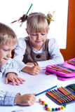 Two drawing kids Royalty Free Stock Photos