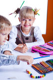 Two drawing kids Stock Photos