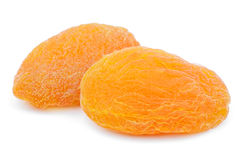Two dried apricot fruits on white Royalty Free Stock Image