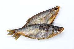 Two dried bream fishes. On a white background Royalty Free Stock Images