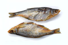 Two dried bream fishes. On a white background Stock Image