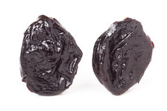 Two dried prunes  on a white background closeup macro Stock Photo