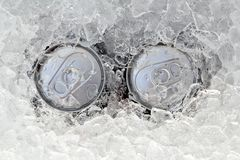 Two drink can iced submerged in frost ice. Closeup stock images