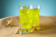Two drinks on the beach Stock Photos