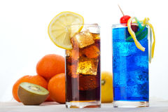 Two drinks. Two different drinks with ice cubes and fruits Stock Images