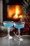 Two drinks by the fire stock photo